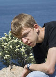 Teen sitting on rocks Stock Image