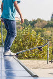 Teen with skateboard ready for a stunt on a half pipe ramp. Teen with skateboard in a starting position for a stunt on a half pipe ramp Stock Photography