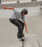 Teen skateboarding Stock Images