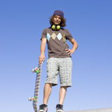 Teen skater atop ramp. Teen skater stands on top of ramp Royalty Free Stock Photo