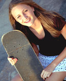 Teen Skater girl. Smiling teen girl with skate board stock photos