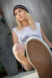 Teen Skater Girl. Sitting with board royalty free stock image
