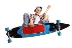 Teen skater jumping with a longboard. Isolated on white background royalty free stock images