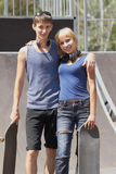 Teen skaters with boards in skatepark Stock Photos