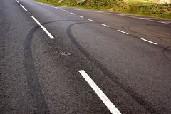 Teen skids. Skid marks left by bored teen drivers at play Royalty Free Stock Image