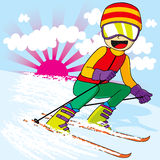 Teen Skiing Fast. Teen skier with colorful sports clothing skiing downhill fast Stock Photography