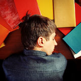 Teen sleep on a Books. Toned Photo of Tired Teenager sleep on the Books at the Home Stock Photo