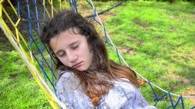 Teen sleeping in a hammock stock footage