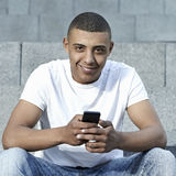 Teen with smartphone Stock Photography