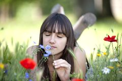 Teen smelling flower Stock Photos