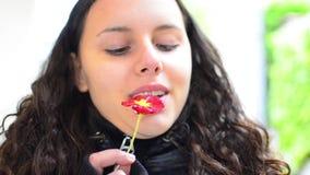 Teen smelling flower Stock Image
