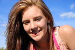 Teen smiling. Young teenager smiling and looking at camera Royalty Free Stock Images