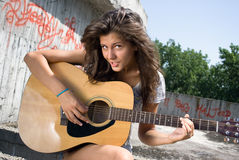 Teen smiling and playing guitar royalty free stock photo