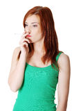 Teen smoking girl. Royalty Free Stock Photography