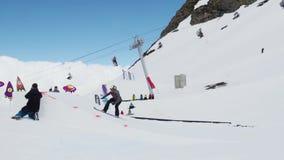 Teen snowboarder jump from springboard. Cardboard cosmic objects. People stock footage