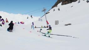 Teen snowboarder jump from springboard. Flip in air. Cardboard cosmic objects. stock footage