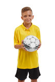 Teen with a soccer ball isolated on a white background. Happy sports boy. Young footballer. School activities concept. Royalty Free Stock Photos