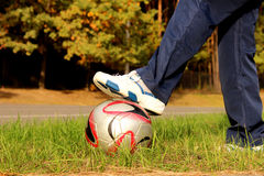 Teen with soccer ball. On stadium Royalty Free Stock Photography