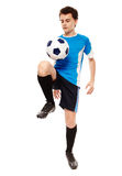 Teen soccer player. Teenager boy soccer player isolated on white background Royalty Free Stock Photo