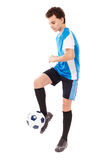 Teen soccer player. Teenager boy soccer player kicking the ball isolated on white background Royalty Free Stock Photo