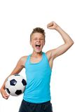Teen soccer player with winning attitude. Close up portrait of teen soccer player with victorious attitude.isolated on white stock photo