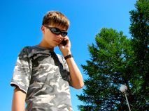 Teen speak phone Royalty Free Stock Photo