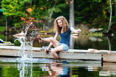 Teen splashing in a lake Royalty Free Stock Images