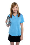 Teen in sports wear posing with a water bottle Stock Photo