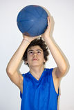 Teen sportsman holding basketball Royalty Free Stock Images