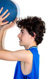 Teen sportsman holding basketball Royalty Free Stock Photo