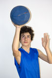 Teen sportsman holding basketball Stock Photo