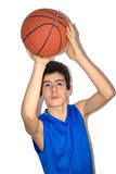 Teen sportsman playing basketball Stock Photos