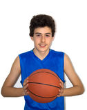 Teen sportsman playing basketball Royalty Free Stock Photos