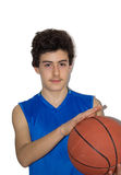 Teen sportsman playing basketball Stock Images