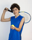 Teen sportsman playing tennis Stock Photos
