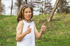 Teen sportsman showing ok sign. Portrait of teen sportsman with long hair Stock Photo
