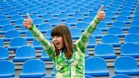 Teen at the stadium with okay Stock Images