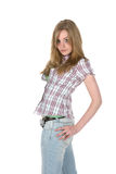 Teen standing with her hand on her hip. Teenage girl standing with her hand on her hip Royalty Free Stock Photography
