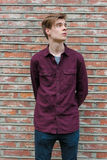 Teen standing over brick vintage wall Stock Photo