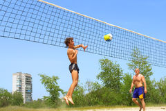 Teen strikes ball into net Royalty Free Stock Photography