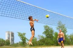 Teen strikes ball into net royalty free stock photography