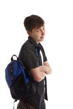 Teen Student. With backpack slung over shoulder.   He has his arms casually folded and is looking over and smiling Royalty Free Stock Photography