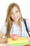 Teen student with books. Happy teen student with books and apple Stock Photos