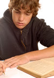 Teen student doing homework Stock Images