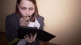 Teen student with ebook reader stock video footage