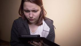 Teen student with ebook reader stock footage