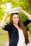 Teen student girl holding books Stock Photo