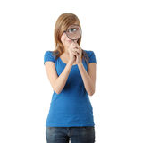 Teen student girl with magnifier Royalty Free Stock Photos