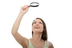 Teen student girl with magnifier Royalty Free Stock Photography