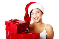 Teen student holding gifts. Royalty Free Stock Photos